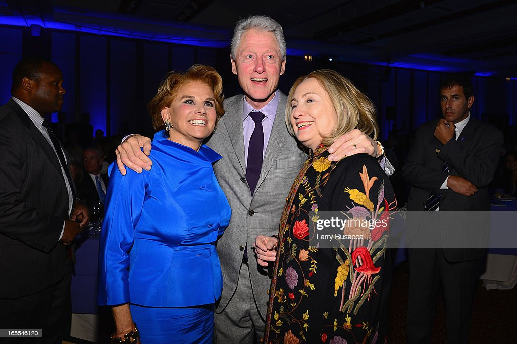 Liz Robbins, Former US President Bill Clinton and Former US Secretary of State Hillary Clinton attend SeriousFun Children's Network event honoring Liz Robbins with celebrity guests at Pier Sixty at Chelsea Piers on April 4, 2013 in New York City.
