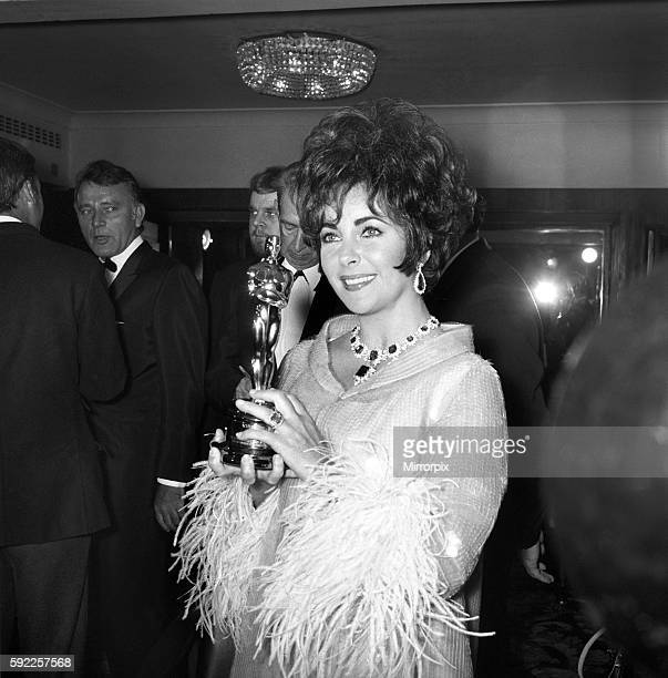 Liz Taylor with the Oscar which was sent from Hollywood for her to receive tonight April 1967 X3882001