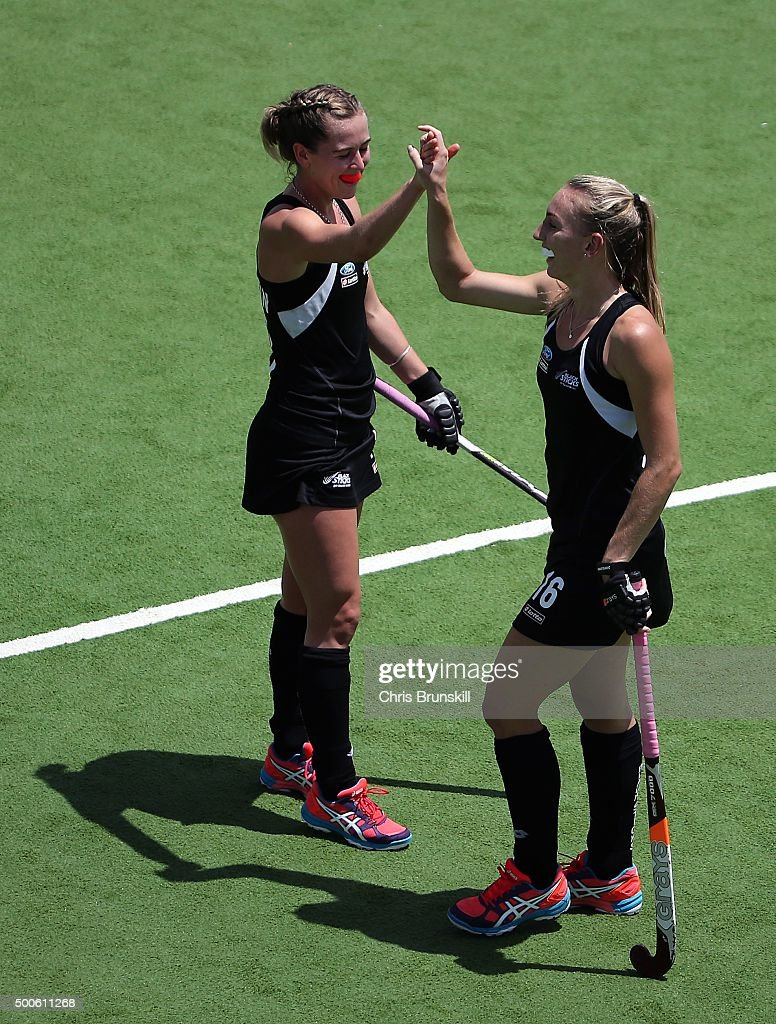 Liz Thompson of New Zealand celebrates scoring her side's third goal against Germany with team-mate <a gi-track='captionPersonalityLinkClicked' href=/galleries/search?phrase=Samantha+Charlton&family=editorial&specificpeople=9604124 ng-click='$event.stopPropagation()'>Samantha Charlton</a> during Day 5 of the Hockey World League Final Rosario 2015 at El Estadio Mundialista on December 9, 2015 in Rosario, Argentina.
