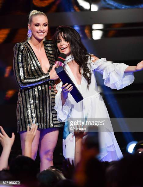 Liz Trinnear presents the award for Best New International Artist to Camilla Cabello at the 2017 iHeartRADIO MuchMusic Video Awards at MuchMusic HQ...