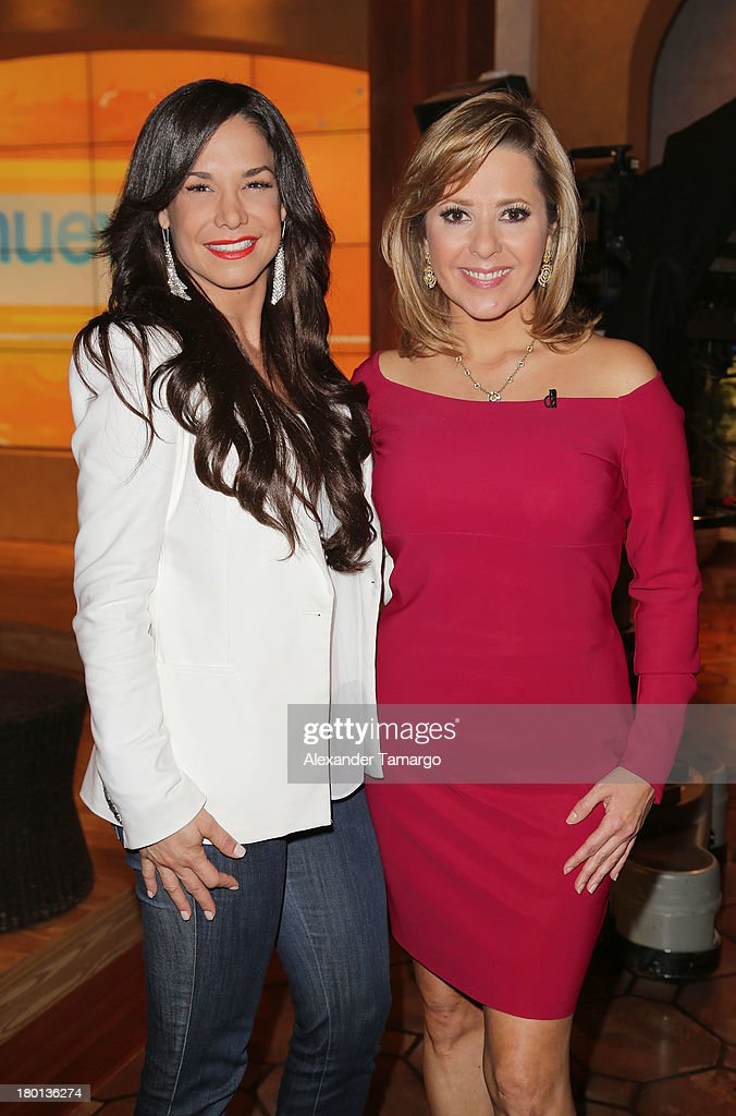 Liz Vega and <a gi-track='captionPersonalityLinkClicked' href=/galleries/search?phrase=Ana+Maria+Canseco&family=editorial&specificpeople=670298 ng-click='$event.stopPropagation()'>Ana Maria Canseco</a> are seen on the set of Telemundo's 'Un Nuevo Dia' at Telemundo Studio on September 9, 2013 in Miami, Florida.