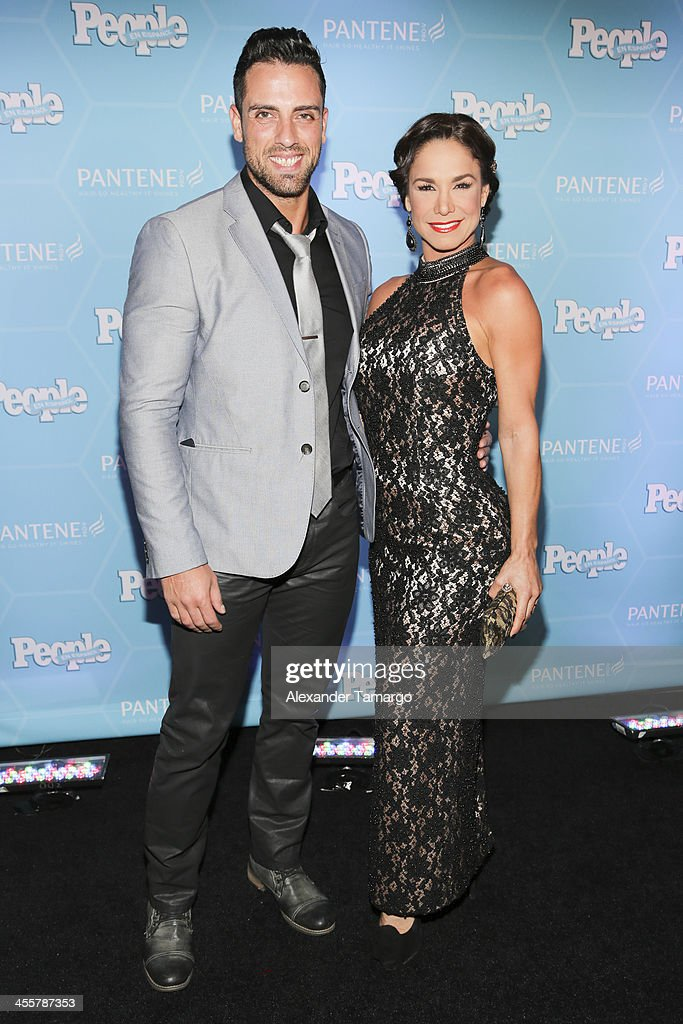 Liz Vega (R) and guest arrive at the Estrellas Del Ano De People En Espanol party at The James Royal Palm Hotel on December 12, 2013 in Miami, Florida.