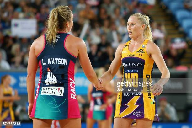 Liz Watson of the Melbourne Vixens and Laura Langman of the Lightning shake hanfs afrer the round 10 Super Netball match between the Vixens and the...
