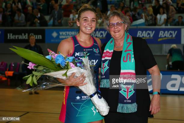 Liz Watson of the Melbourne Vixens is presented with flowers after reaching the 50 game milestone after the round 10 Super Netball match between the...