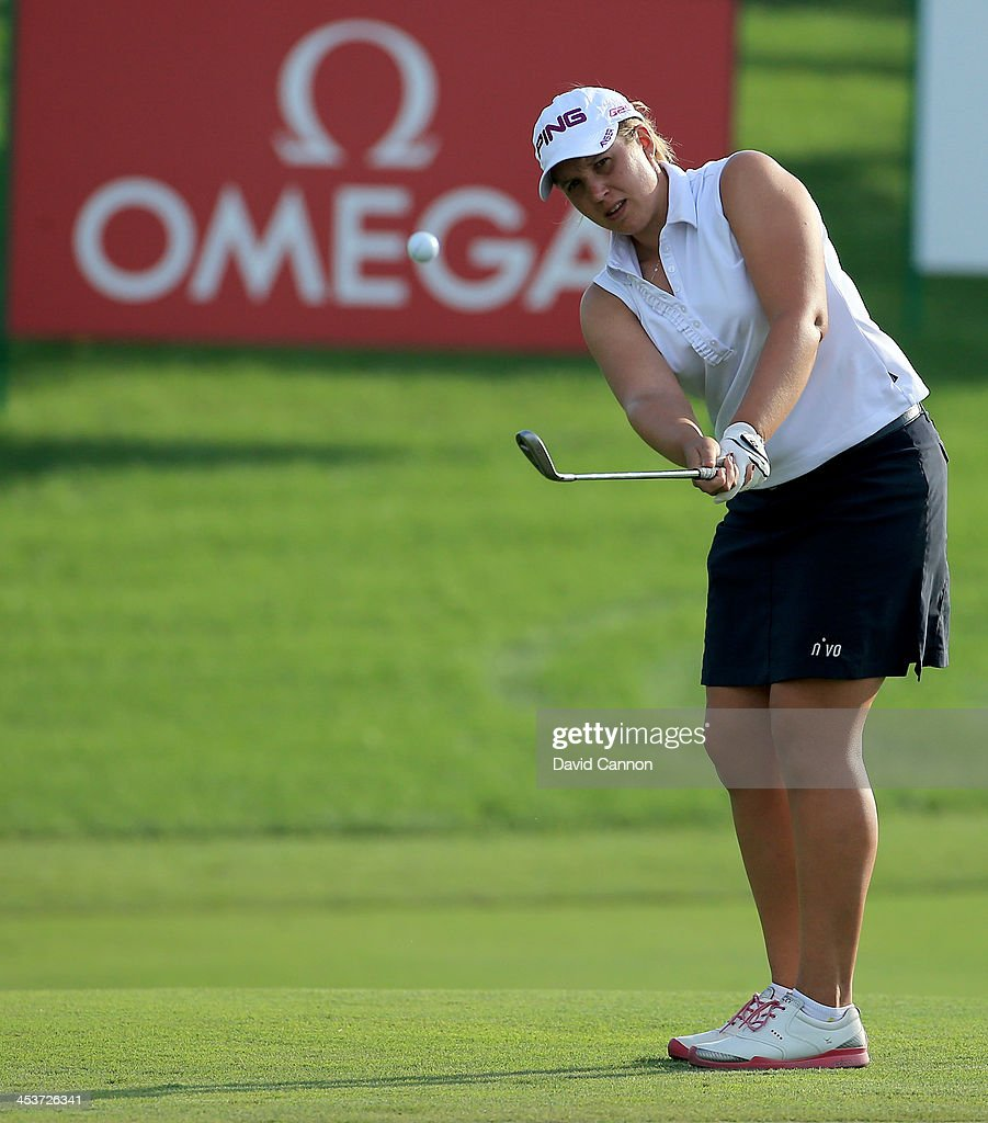 Liz Young of England plays her third shot at the par 4, first hole during the second round of the 2013 Omega Dubai Ladies Masters on the Majilis Course at the Emirates Golf Club on December 5, 2013 in Dubai, United Arab Emirates.