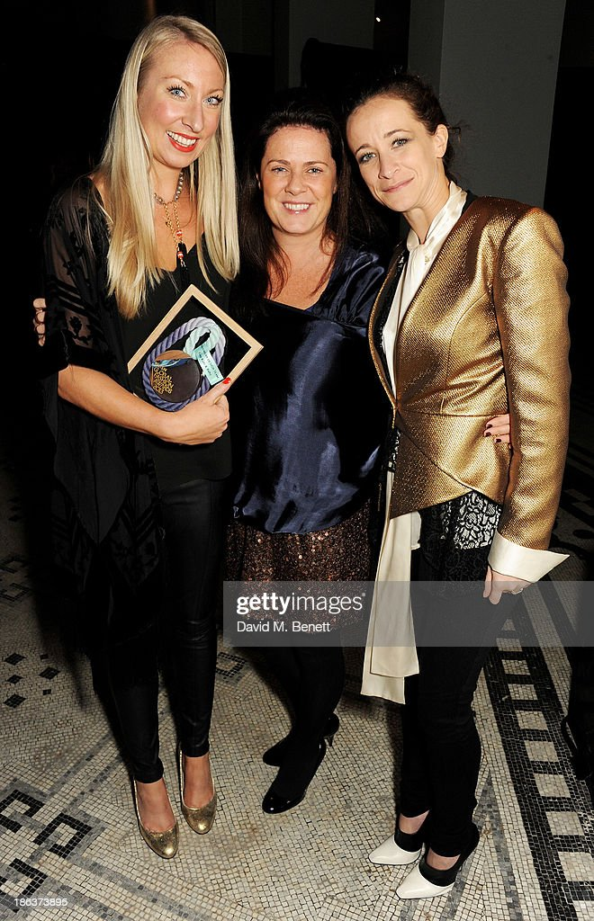 Liza Humphrey and Zoe Matthew of Gap Kids and Baby, winners of the Kidswear Design Team award, and Leah Wood pose backstage at The WGSN Global Fashion Awards at the Victoria & Albert Museum on October 30, 2013 in London, England.