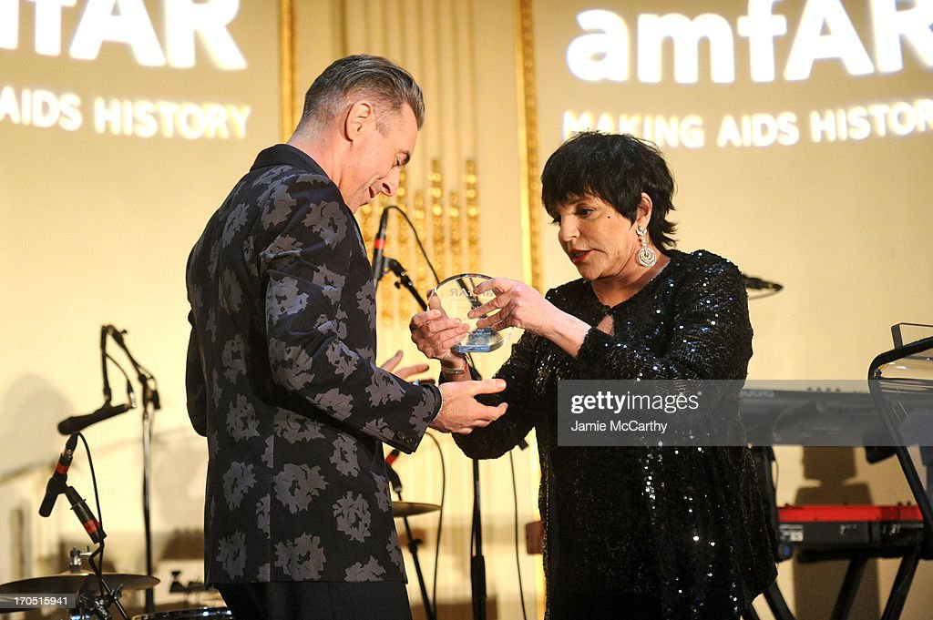 Liza Minelli presents the Award of Courage to Alan Cumming on stage during the 4th Annual amfAR Inspiration Gala New York at The Plaza Hotel on June 13, 2013 in New York City.