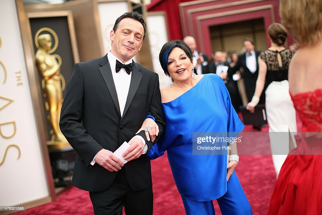 Liza Minnelli (R) and a guest attend the Oscars at Hollywood & Highland Center on March 2, 2014 in Hollywood, California.