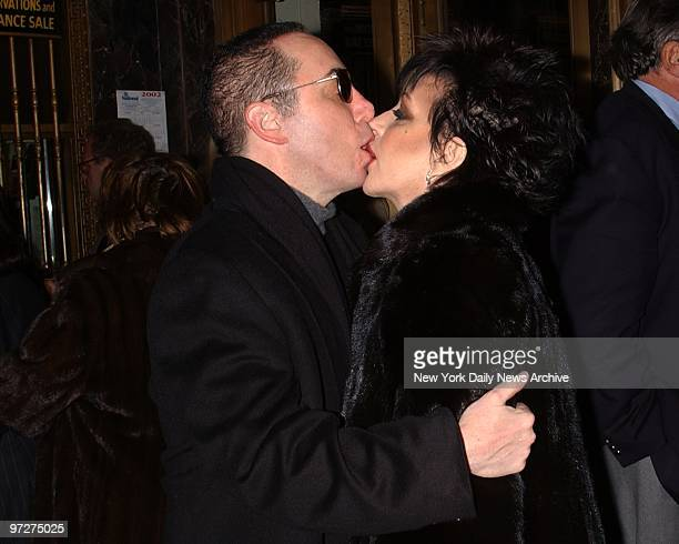 Liza Minnelli and fiance David Gest kiss as the two attend the Broadway show 'Elaine Stritch at Liberty' at the Neil Simon Theatre on W 52nd St