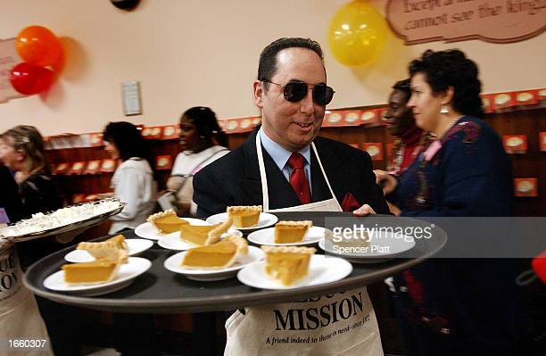Liza Minnelli and husband David Gest serve food during a Thanksgiving meal at the New York City Rescue Mission at the New York City Rescue Mission...