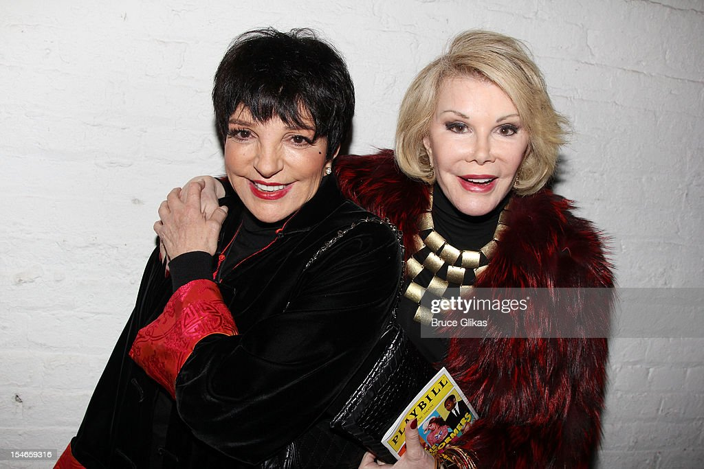 Liza Minnelli and Joan Rivers pose backstage at the hit comedy 'The Performers' on Broadway at The Longacre Theater on October 23 2012 in New York...