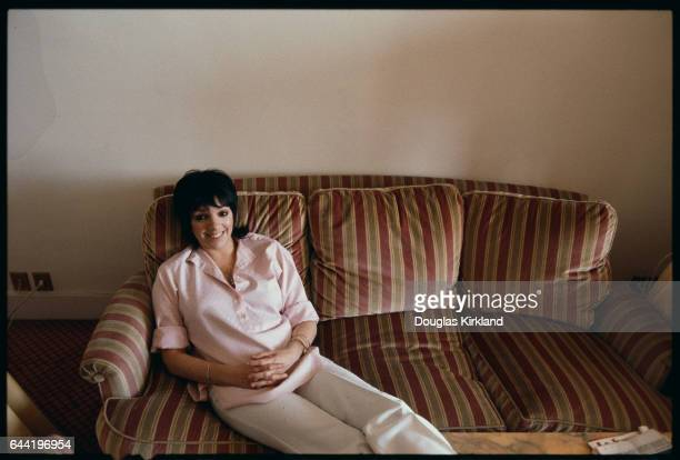 Liza Minnelli Sitting on a Couch