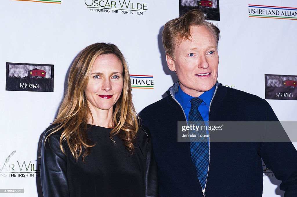 Liza Powel and TV Personality/Honoree <a gi-track='captionPersonalityLinkClicked' href=/galleries/search?phrase=Conan+O%27Brien&family=editorial&specificpeople=208095 ng-click='$event.stopPropagation()'>Conan O'Brien</a> attends the 9th Annual 'Oscar Wilde: Honoring The Irish In Film' Pre-Academy Awards event at Bad Robot on February 27, 2014 in Santa Monica, California.