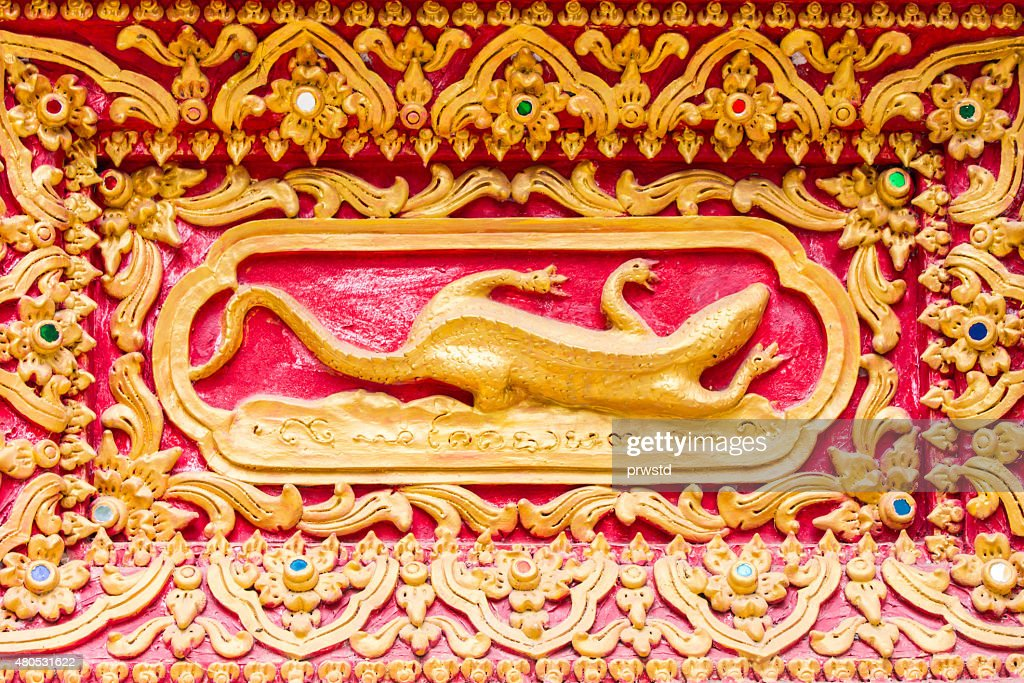 lizard Wall sculpture in Thai temple : Stock Photo
