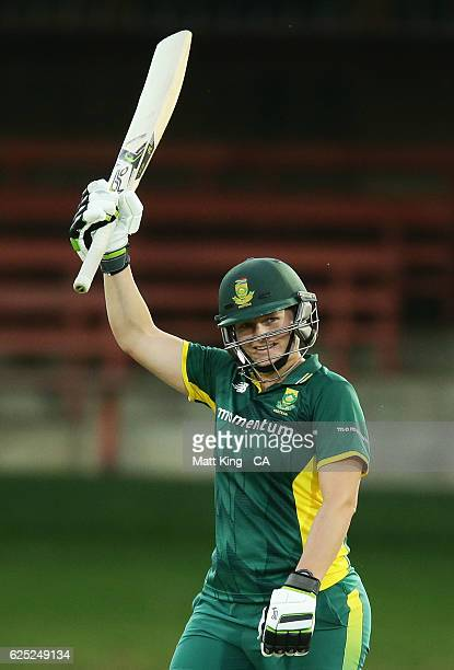 Lizelle Lee of South Africa celebrates and acknowledges the crowd after scoring a century during the women's One Day International match between the...
