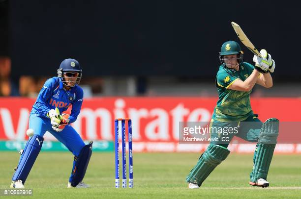 Lizelle Lee of South Africa hits the ball towards the boundary as Sushma Verma of India looks on during the ICC Women's World Cup 2017 match between...