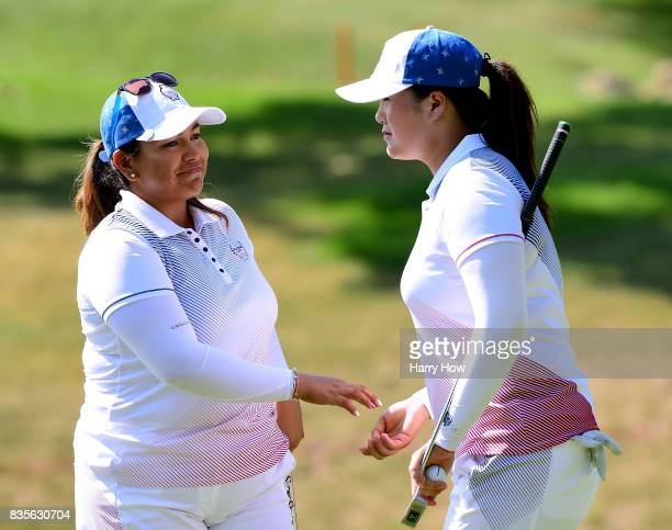 Lizette Salas of Team USA celebrates her putt with Angel Yin to halve the 12th hole during the evening fourball matches of the Solheim Cup at the Des...