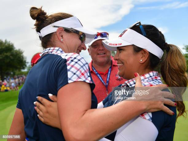 Lizette Salas of Team USA celebrates with Brittany Lang on the 18th hole during the final day singles matches of The Solheim Cup at Des Moines Golf...
