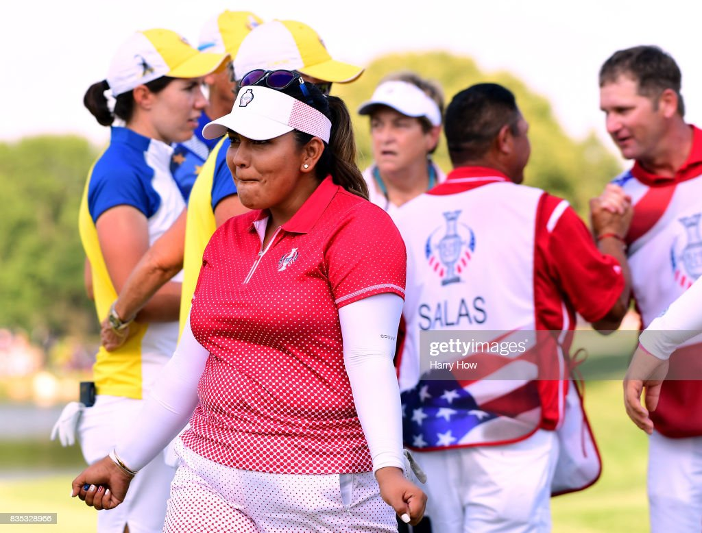 Lizette Salas of Team USA dances in celebration of a six and five win over Team europe during the afternoon four-ball matches of the Solheim Cup at the Des Moines Golf and Country Club on August 18, 2017 in West Des Moines, Iowa.