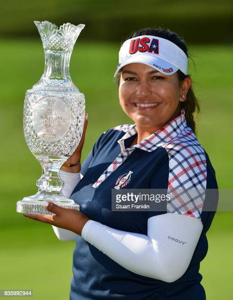 Lizette Salas of Team USA holds the Solheim Cup trophy after the final day singles matches of The Solheim Cup at Des Moines Golf and Country Club on...