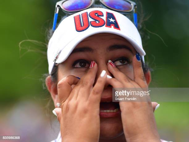 Lizette Salas of Team USA wipes away the tears on the 18th hole during the final day singles matches of The Solheim Cup at Des Moines Golf and...