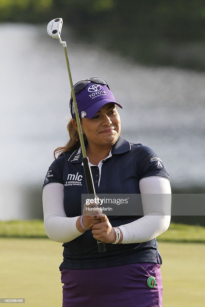 <a gi-track='captionPersonalityLinkClicked' href=/galleries/search?phrase=Lizette+Salas&family=editorial&specificpeople=7883974 ng-click='$event.stopPropagation()'>Lizette Salas</a> smiles after hitting her putt on the 18th hole during the final round of the Kingsmill Championship presented by JTBC on the River Course at Kingsmill Resort on May 18, 2014 in Williamsburg, Virginia.
