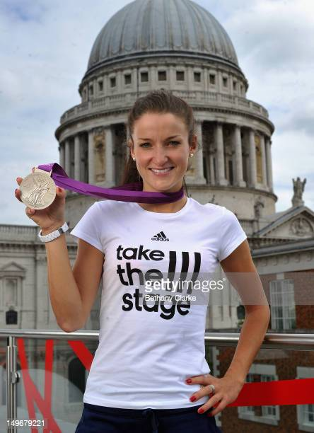 Lizzie Armitstead of Great Britain poses with her silver medal in front of St Paul's cathedral on August 2 2012 in London England