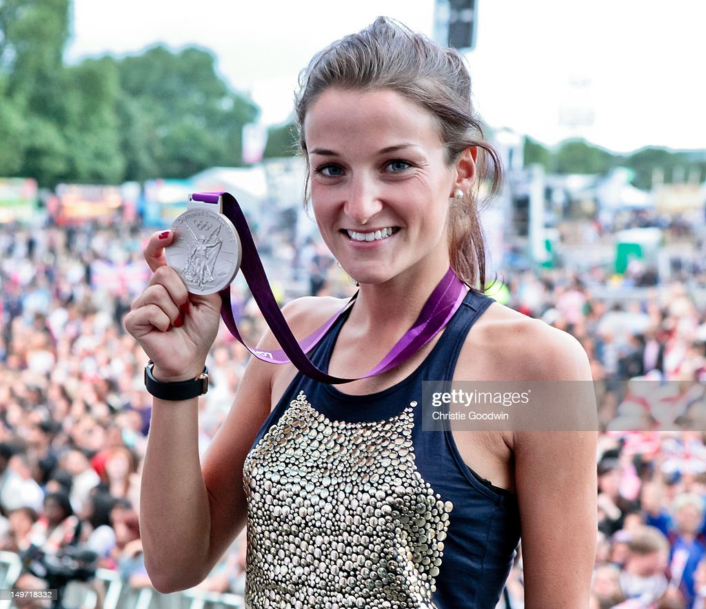 Lizzie Armitstead who came second in the cycling road race at the London 2012 Olympics pose on stage with her silver medal during BT London Live at Hyde Park on August 2, 2012 in London, United Kingdom.