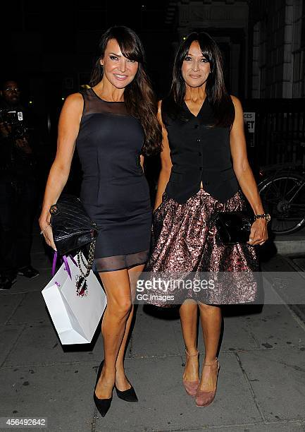 Lizzie Cundy and Jackie Sinclair arrive at Cafe kaiZen for Cherry Edit's fashion web site launch party on October 1 2014 in London England