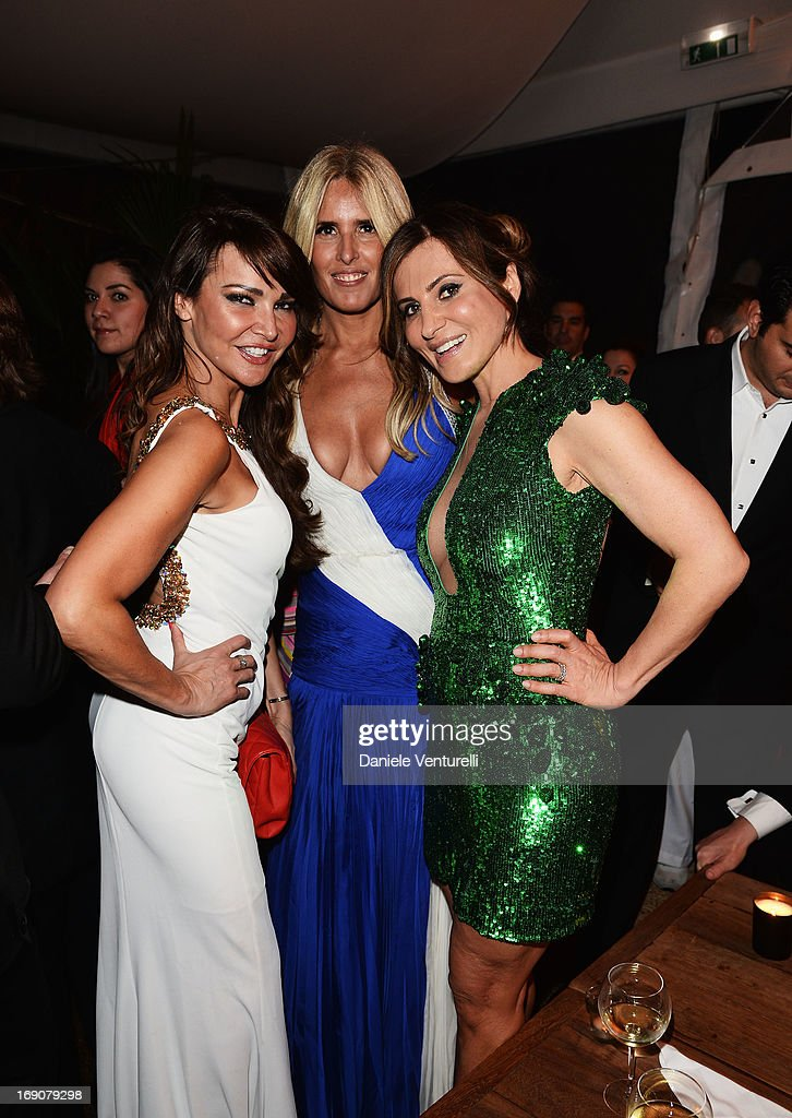 <a gi-track='captionPersonalityLinkClicked' href=/galleries/search?phrase=Lizzie+Cundy&family=editorial&specificpeople=4697352 ng-click='$event.stopPropagation()'>Lizzie Cundy</a> (L), <a gi-track='captionPersonalityLinkClicked' href=/galleries/search?phrase=Tiziana+Rocca&family=editorial&specificpeople=863159 ng-click='$event.stopPropagation()'>Tiziana Rocca</a> (C) and a guest attend the Eva Longoria Global Gift Gala after party hosted by Nikki Beach Cannes during The 66th Annual Cannes Film Festival on May 19, 2013 in Cannes, France.