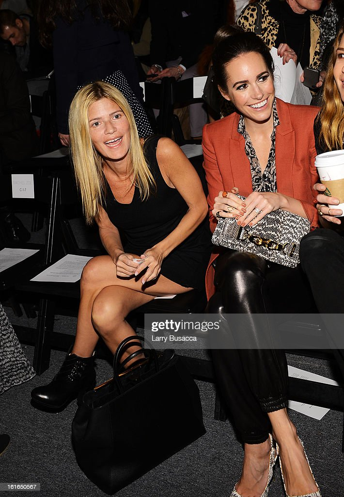 Lizzie Grubman (L) and Louise Row attend the Rachel Zoe Fall 2013 fashion show during Mercedes-Benz Fashion Week at The Studio at Lincoln Center on February 13, 2013 in New York City.