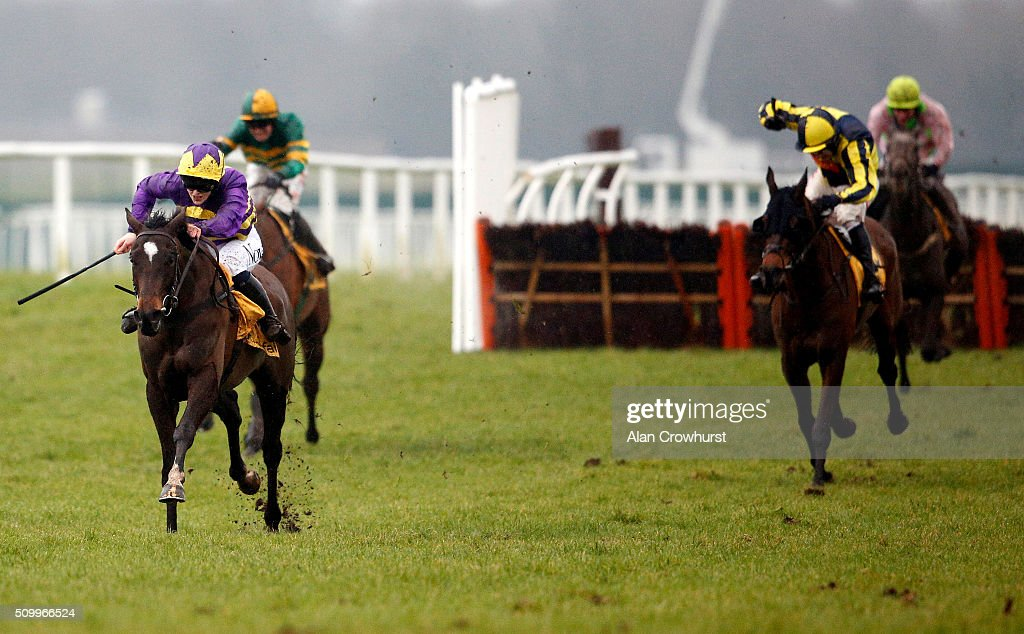 Lizzie Kelly riding Agrapart (L, purple) clear the last to win The Betfair Hurdle Race at Newbury racecourse on February 13, 2016 in Newbury, England.