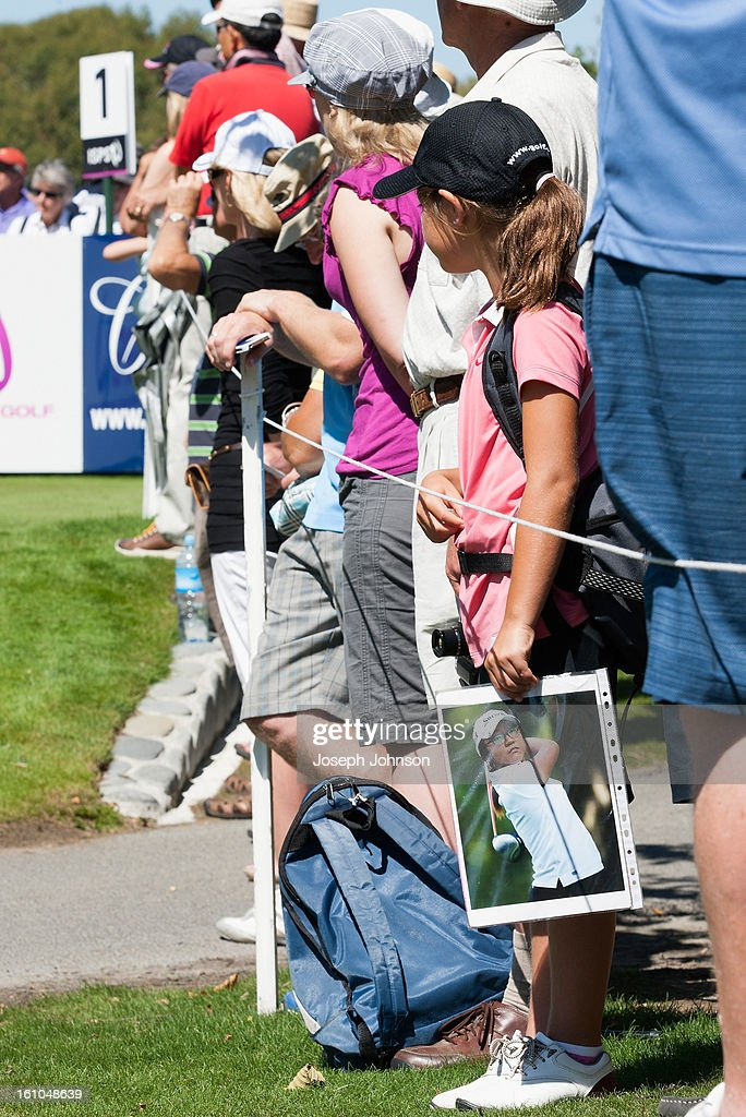 Lizzie Neale, 9 years old of Nelson, holds a photo of Lydia Ko during day two of the New Zealand women's golf open at Clearwater Golf Course on February 9, 2013 in Christchurch, New Zealand.