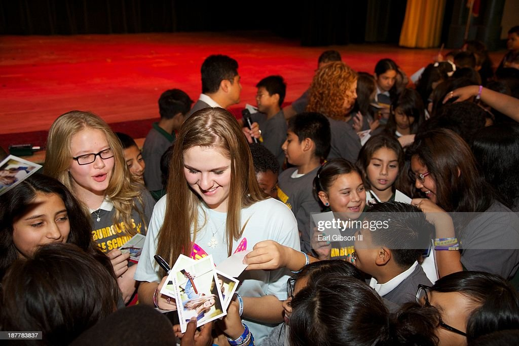 Lizzie Sider signs autographs for her fans at the John Burroughs Middle School after her National Bullying Prevention Campaign on November 12, 2013 in Los Angeles, California.