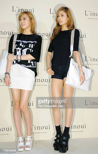 Lizzy and NANA of After School attend the 'L'inoui' Lotte department store opening on August 31 2013 in Seoul South Korea