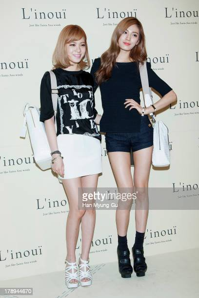 Lizzy and Nana of South Korean girl group After School attend during the opening of luxury bag brand 'Linoui' at Lotte Department Store on August 31...