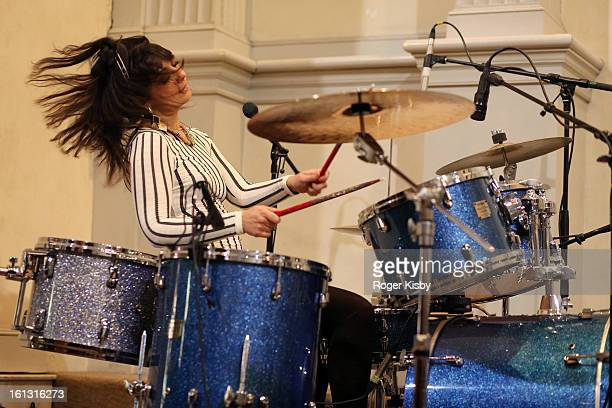 Lizzy Bougatsos of IUD performs onstage at the Chloe Sevigny for Opening Ceremony MercedesBenz Fashion Presentation at Saint Marks Church on February...