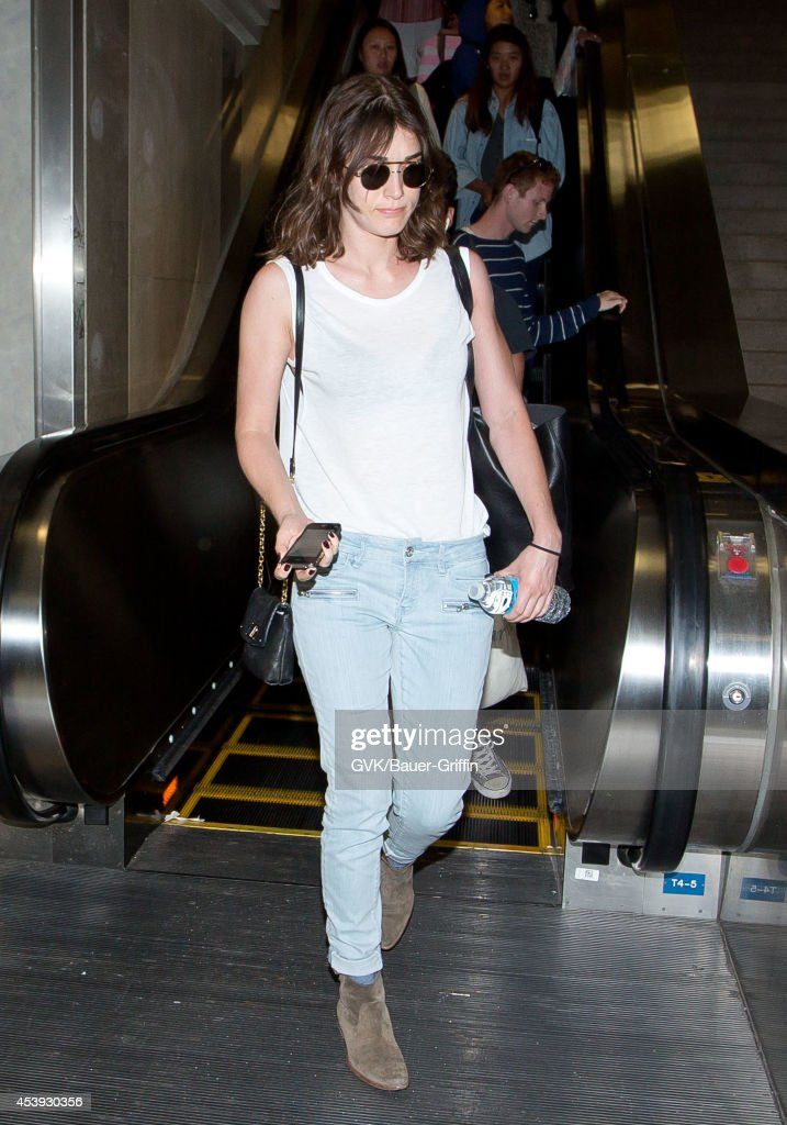 <a gi-track='captionPersonalityLinkClicked' href=/galleries/search?phrase=Lizzy+Caplan&family=editorial&specificpeople=599560 ng-click='$event.stopPropagation()'>Lizzy Caplan</a> seen at LAX on August 21, 2014 in Los Angeles, California.