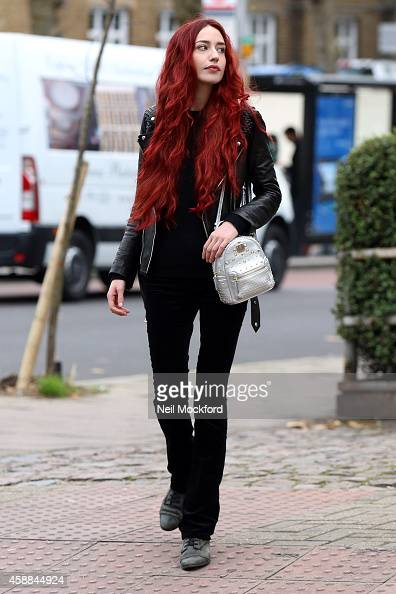 Lizzy Jagger carries a MCM silver Bebe Boo rucksack on November 11 2014 in London England
