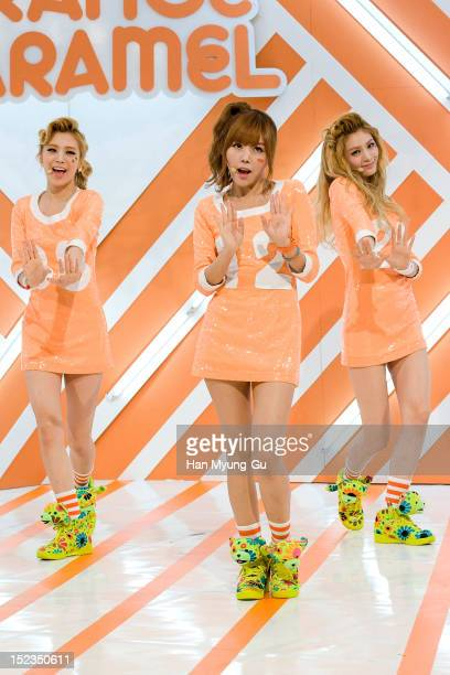 Lizzy Raina and Nana of South Korean girl group Orange Caramel perform during the MBC Music 'Show Champion' on September 18 2012 in Seoul South Korea