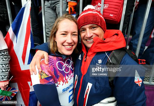 Lizzy Yarnold of Great Britain celebrates winning the gold medal with her boyfriend and coach James Roche during the Women's Skeleton on Day 7 of the...