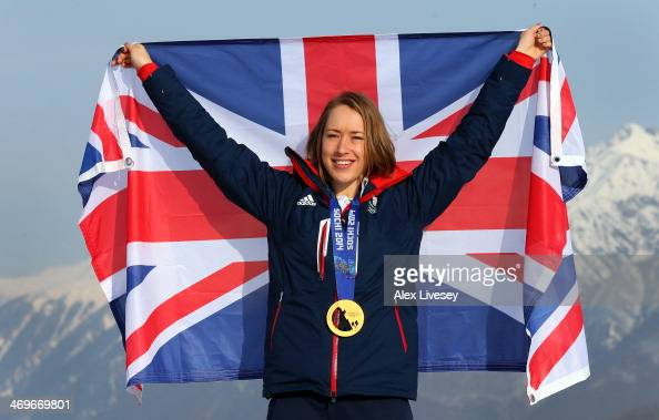 Lizzy Yarnold of Great Britain stands with her gold medal and the Union Jack flag after winning the Women's Skelton as she poses for a portrait at...