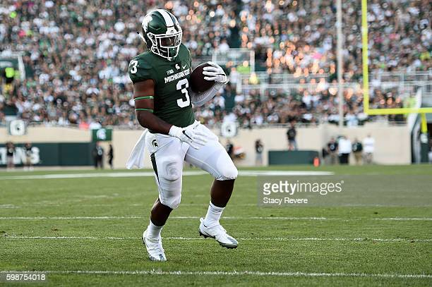 Lj Scott of the Michigan State Spartans rushes for a touchdown during the first half of a game against the Furman Paladins at Spartan Stadium on...