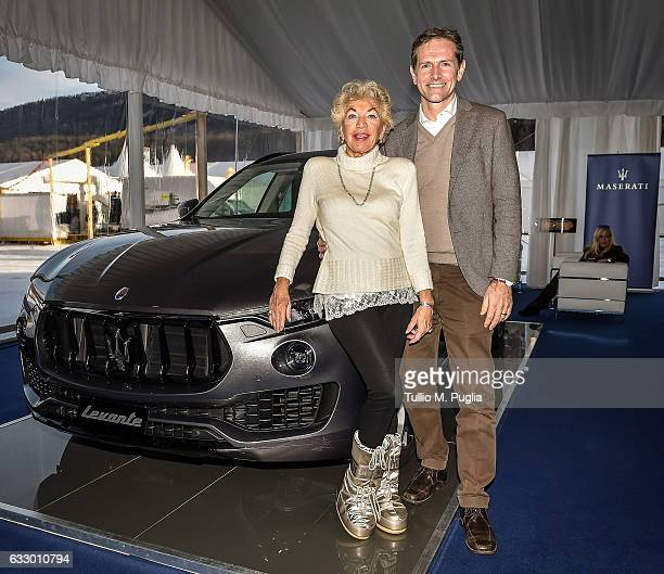 Ljuba ManzLurje of Manz Lurie Privacy Hotel Switzerland and her husband Marco Conte pose near a Maserati Levante during Snow Polo World Cup St Morits...