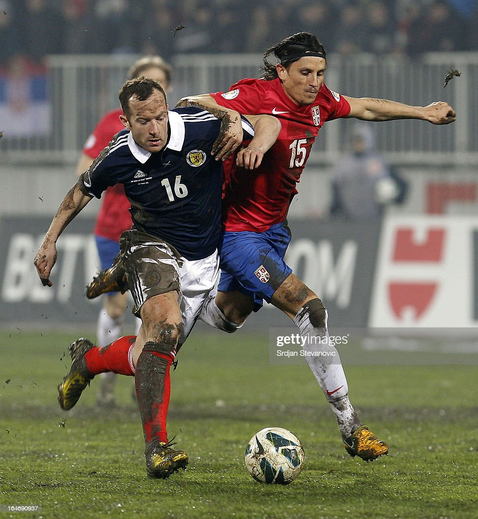 Ljubisa Fejsa (R) of Serbia battles for the ball with Charlie Adam (L) of Scotland during the FIFA 2014 World Cup Qualifier between Serbia and Scotland at Karadjordje Stadium on March 26, 2013 in Novi Sad, Serbia.