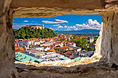 Ljubljana aerial view through stone window, capital of Slovenia