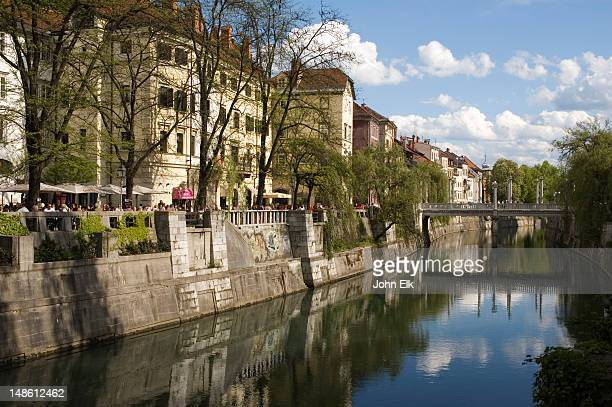 Ljubljanica River banks with outdoor cafes and restaurants.