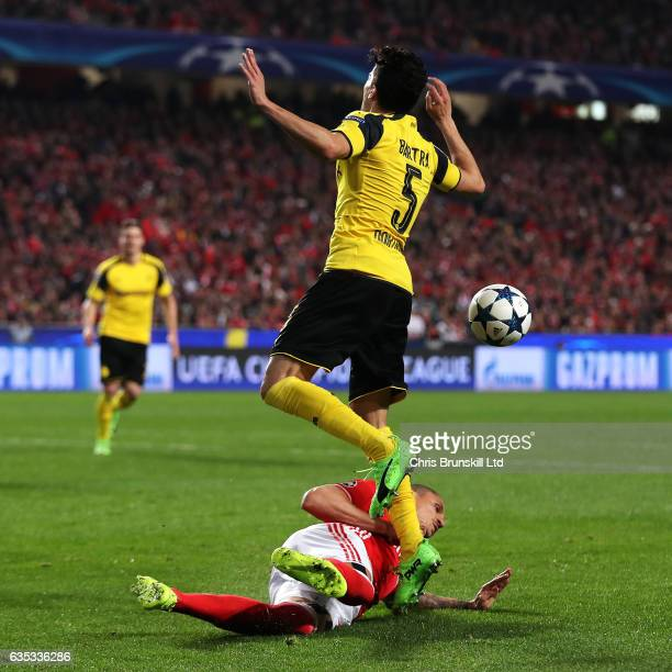Ljubomir Fejsa of SL Benfica fouls Marc Bartra of Borussia Dortmund for a penalty during the UEFA Champions League Round of 16 first leg match...