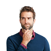 Studio shot of a man looking unsure against a white background