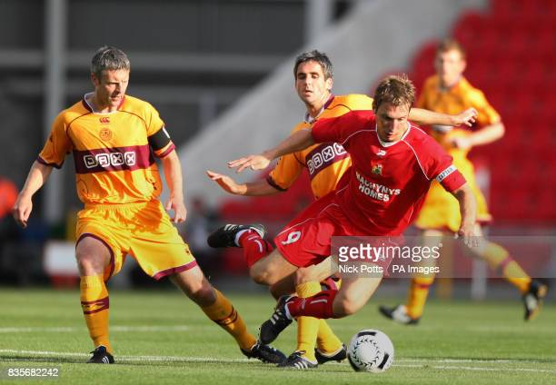 Llanelli captain Ryhs Griffiths skips over tackle from Motherwell's Keith Lasley with Stephen Craigan during the Europa League Qualifying Second Leg...